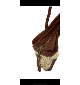 Leather bag and palm leaves Hind